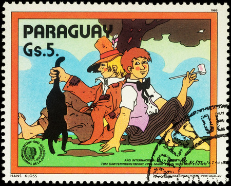 waif: MOSCOW, RUSSIA - MAY 23, 2016: A stamp printed in Paraguay shows Tom Sawyer and Huckleberry Finn are sitting under a tree, series International Youth Year, circa 1985 Editorial