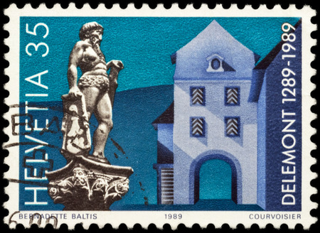 helvetia: MOSCOW, RUSSIA - JUNE 02, 2016: A stamp printed in Switzerland shows ancient Swiss city Delemont, devoted to the 700th Anniversary of Delemont, circa 1989
