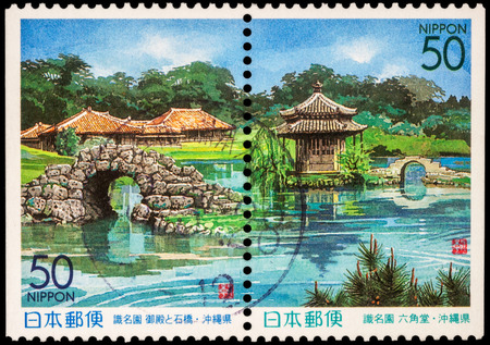 "RUSSIA - JUNE 02, 2016: A stamp printed in Japan shows japanese garden with pond and bridges, series ""Prefectural Stamps - Okinawa"", circa 1999"