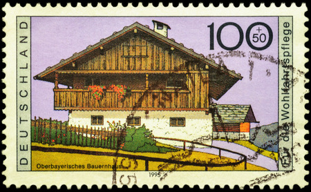 farmhouses: MOSCOW, RUSSIA - JUNE 02, 2016: A stamp printed in Germany shows Upper Bavarian farmhouse, series Charity Stamps - Farmhouses, circa 1995 Editorial