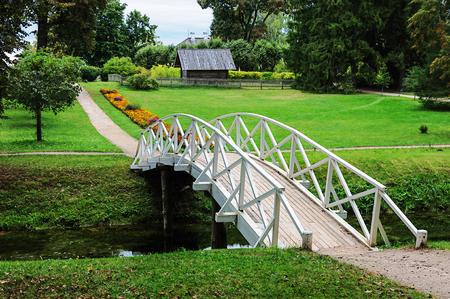gory: White wooden bridge in old park of the village Mikhailovskoye, Pushkinskiye Gory Reserve, Russia
