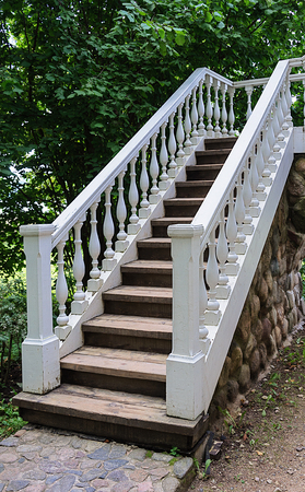 banister: White staircase with banister in summer park Stock Photo