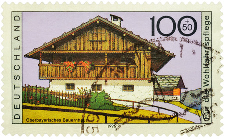 bayern old town: MOSCOW, RUSSIA - JUNE 02, 2016: A stamp printed in Germany shows Upper Bavarian farmhouse, series Charity Stamps - Farmhouses, circa 1995 Editorial