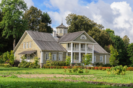 gory: Manor house of P.A.Gannibal with a lawn and trees in the village Petrovskoye, Pushkinskiye Gory Reserve, Russia