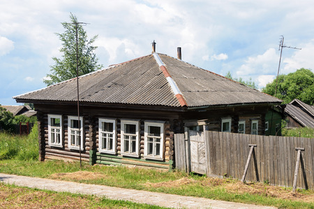 Old abandoned wooden house in russian village, sunny summer day Stock Photo