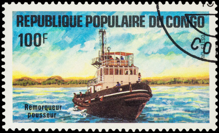MOSCOW, RUSSIA - AUGUST 05, 2016: A stamp printed in Congo shows image of pusher tug, series Transport - Ships, circa 1984 Editorial