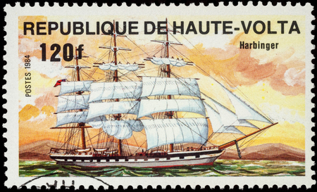harbinger: MOSCOW, RUSSIA - AUGUST 04, 2016: A stamp printed in Upper Volta shows sails Harbinger, series Ships, circa 1984 Editorial