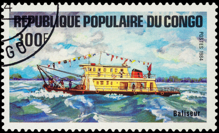 MOSCOW, RUSSIA - AUGUST 05, 2016: A stamp printed in Congo shows image of small motor ship, series Transport - Ships, circa 1984