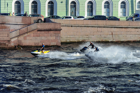 Male group on jet ski on the Neva river in St. Petersburg, Russia