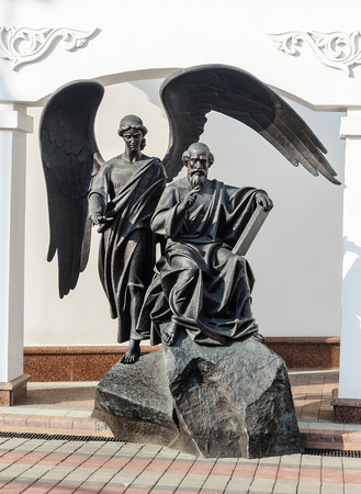 Statue of Saint Apostle and Evangelist John the Theologian near the Spiritual and Educational Center of the Belarusian Orthodox Church in Minsk, Belarus. Author - Alexander Dranets. Stock Photo