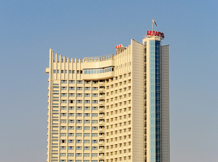 Top of three-star hotel Belarus in Minsk at sunset