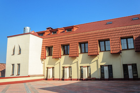 New building with red tiled roof in Trinity Suburb, Minsk, Belarus