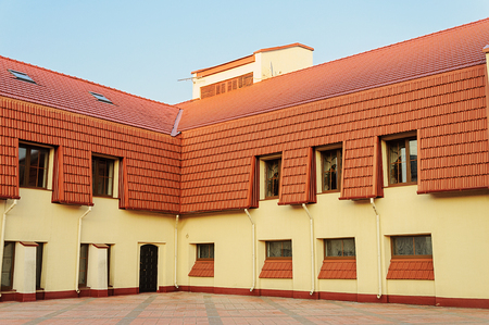 New two-storeyed building with red tiled roof in Trinity Suburb of Minsk, Belarus