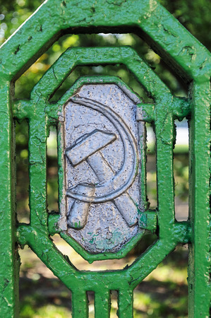 totalitarianism: Soviet symbols (hammer and sickle) on the old metal fence in Minsk, Belarus
