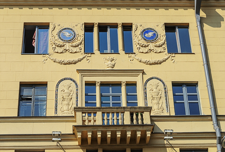 Fragment of old building with balcony and bas-relief (Stalins empire) in Minsk, Belarus Stock Photo