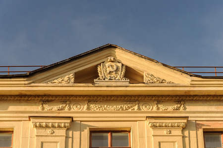 totalitarianism: Soviet symbols (hammer and sickle) on the gable of old building in Minsk, Belarus Editorial
