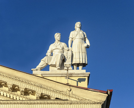 Sculpture of man and women on the roof of Trade Union Palace in Minsk, Belarus. Stalins era style.