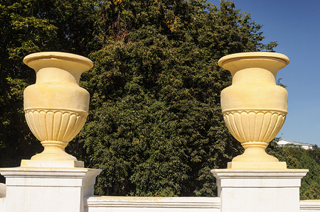 Two old big yellow flowerpots on Independence Avenue in Minsk, Belarus. Stalins empire.