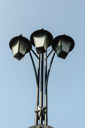 Three old electric street lamps in retro style, Minsk, Belarus
