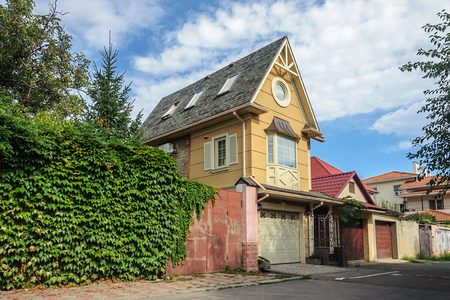 Small brick private two-storied residential house in Odessa, Ukraine. Sunny summer day Stock Photo