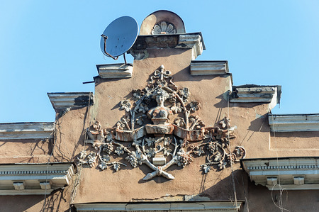 pediment: Coat of arms on the pediment of old building in Odessa, Ukraine