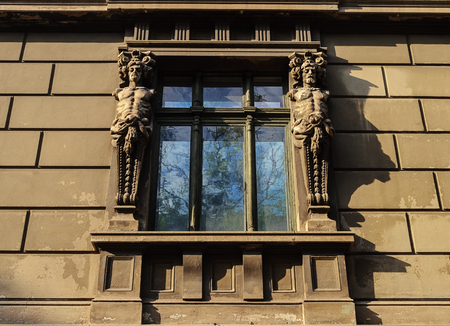 Window of old building with caryatids in Odessa, Ukraine