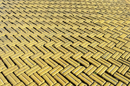 Yellow tiles, the surface of the carriageway on Deribasovskaya Street in Odessa