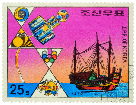 MOSCOW, RUSSIA - NOVEMBER 02, 2016: A stamp printed in DPRK (North Korea) shows ancient asian sailing ship (junk) and modern satellite, circa 1976
