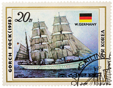 MOSCOW, RUSSIA - NOVEMBER 04, 2016: A stamp printed in DPRK (North Korea) shows image of Gorch Fock II, a tall ship of the German Navy (1958) and flag of Germany, series Sailing Ships, circa 1987 Editorial
