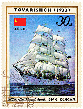 MOSCOW, RUSSIA - NOVEMBER 04, 2016: A stamp printed in DPRK (North Korea) shows image of Russian sail training barque Tovarishch (1933) and flag of USSR, series Sailing Ships, circa 1987
