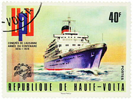 upu: MOSCOW, RUSSIA - NOVEMBER 06, 2016: A stamp printed in Upper Volta (Burkina Faso) shows old cruise ship, series The 100th Anniversary of UPU Congress in Lausanne circa 1974 Editorial