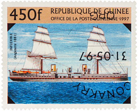 MOSCOW, RUSSIA - NOVEMBER 06, 2016: A stamp printed in Guinea shows battleship of the Royal Navy Fleet UK Inflexible (1881), series The 19th-Century Warships, circa 1997 Editorial