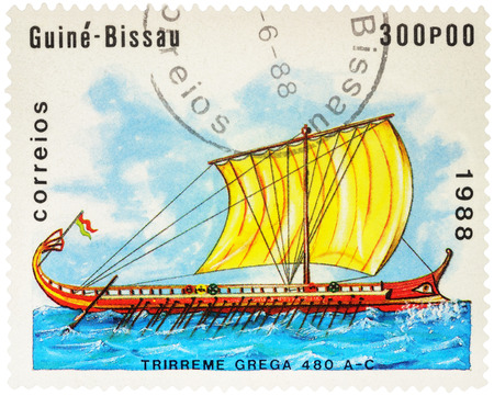 MOSCOW, RUSSIA - NOVEMBER 04, 2016: A stamp printed in Guinea-Bissau shows image of ancient Greek trireme, series Sailing Ships, circa 1988