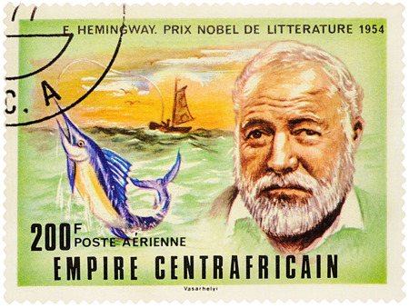 hemingway: MOSCOW, RUSSIA - NOVEMBER 09, 2016: A stamp printed in Central African Republic, shows portrait of American writer Ernest Hemingway (1899-1961), series Nobel Prize  Winners, circa 1977