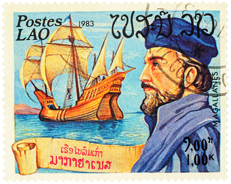 MOSCOW, RUSSIA - NOVEMBER 08, 2016: A stamp printed in Laos shows Ferdinand Magellan and his ship Victoria, series Explorers and their Ships, circa 1983 Editorial