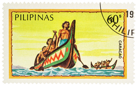 MOSCOW, RUSSIA - NOVEMBER 15, 2016: A stamp printed in Philippines shows group of aborigines rowing traditional pirogue in the ocean, series Water Transport, circa 1984 Editorial
