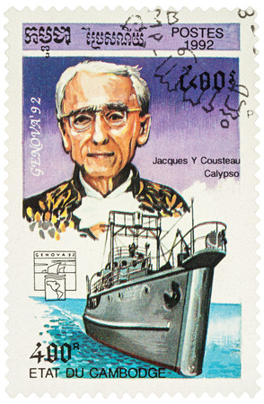 MOSCOW, RUSSIA - NOVEMBER 12, 2016: A stamp printed in Cambodia shows French ocean explorer Jacques Cousteau and his ship Calypso, series Exhibition Genova 92 - Navigators and their Ships, circa 1992 Editorial