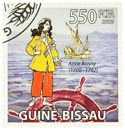 irish woman: MOSCOW, RUSSIA - NOVEMBER 12, 2016: A stamp printed in Guinea shows Anne Bonny - an Irish woman, a famous pirate in the Caribbean, series Transport - Ships & Pirates, circa 2009