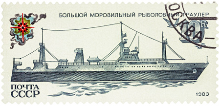 fishing fleet: MOSCOW, RUSSIA - NOVEMBER 25, 2016: A stamp printed in USSR (Russia) shows deep sea trawler, series Fishing Vessels, circa 1983