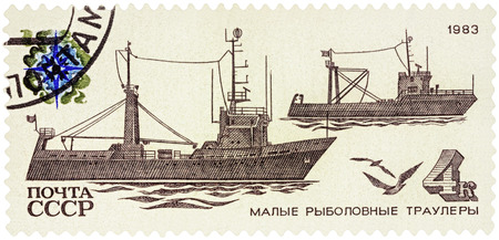 fishing fleet: MOSCOW, RUSSIA - NOVEMBER 25, 2016: A stamp printed in USSR (Russia) shows coastal trawlers, series Fishing Vessels, circa 1983
