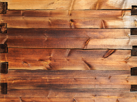 Texture of old wooden wall made of timber, jointed