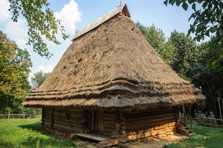 thatched roof: Lviv, Ukraine - September 09, 2016: Old Ukrainian authentic wooden house with thatched roof from Transcarpathian region, Ukraine. Now in Museum of Folk Architecture in Lviv