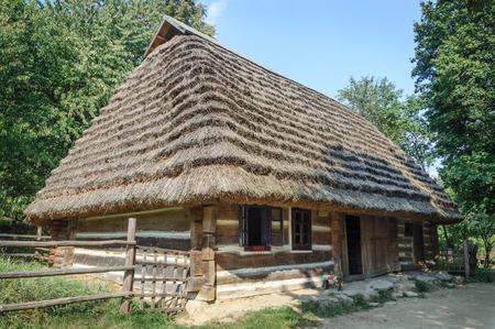 thatched roof: Lviv, Ukraine - September 09, 2016: Old Ukrainian authentic wooden house with thatched roof from Mshanets village, Lviv region, Ukraine. Now in Museum of Folk Architecture in Lviv Editorial