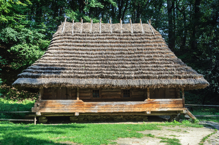 thatched roof: Lviv, Ukraine - September 09, 2016: Authentic Ukrainian wooden house with thatched roof from Oriavchik village, Boykos region, Ukraine. Now in Museum of Folk Architecture in Lviv