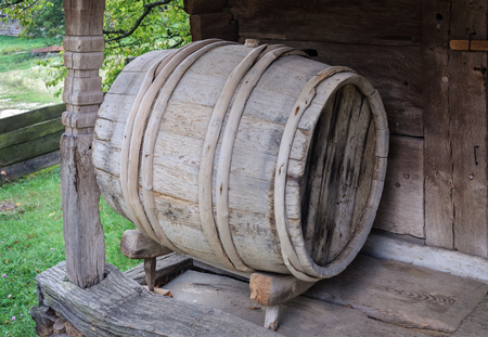 hogshead: Old wooden wine barrel at the shed in Ukrainian village