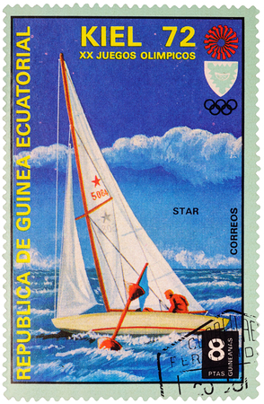 olympic games: MOSCOW, RUSSIA - January 09, 2017: A stamp printed in Equatorial Guinea shows yachting, the race in Star class, series Olympic Games - Munich, Germany, circa 1972 Editorial