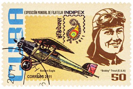 aguila real: MOSCOW, RUSSIA - January 14, 2017: A stamp printed in Cuba shows American aviator Evelyn Bobbi Trout and her airplane Golden Eagle, series International Stamp Exhibition INDIPEX 2011, circa 2011 Editorial