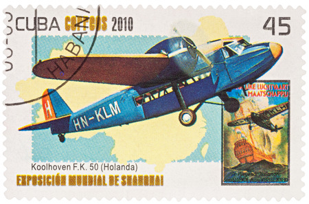 monoplane: MOSCOW, RUSSIA - January 12, 2017: A stamp printed in Cuba shows old Dutch passenger airplane Koolhoven F.K.50 (1930s), series World EXPO 2010 - Shanghai, China, circa 2010