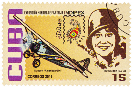 MOSCOW, RUSSIA - January 15, 2017: A stamp printed in Cuba shows American pilot Ruth Elder and her airplane Stinson American Girl, series International Stamp Exhibition INDIPEX 2011, circa 2011 Editorial