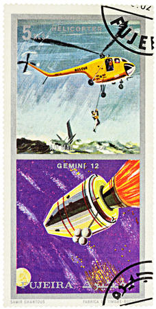MOSCOW, RUSSIA - January 25, 2017: A stamp printed in Fujeira shows spacecraft Gemini 12 and helicopter, series Air and Space Vehicles, circa 1971 Editorial